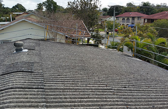 Is our asbestos roof an environmental hazard